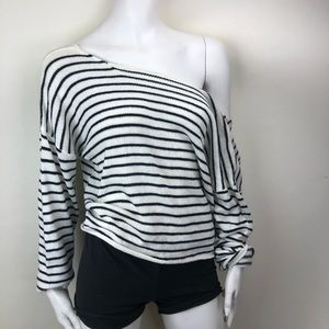 Sweater with twisted back detail.